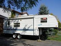 A fifth wheel trailer for sale.