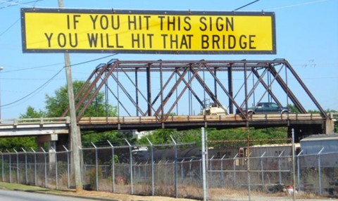 Sign before bridge: 'If you hit this sign, you'll hit that bridge.'
