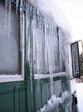 buildup-of-snow-ice-on-roof-by-origamidon.jpg