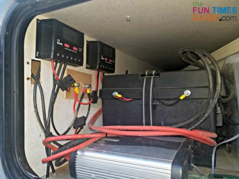 Two charge controllers and battery bank in the side compartment