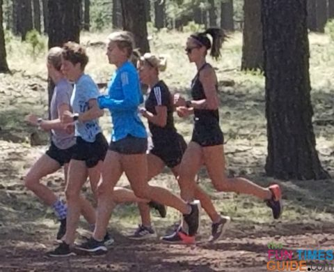 The local college girls cross country team running on Forest Roads