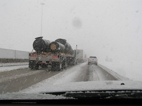 driving-on-busy-road-in-thick-blinding-snow-by-bjmccray.jpg