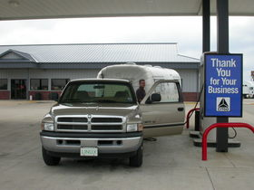 filling-up-gas-pickup-truck-trailer-by-NCreedplayer.jpg