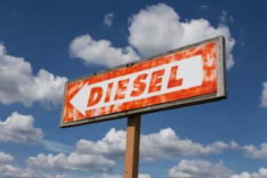 A rustic sign points to a location where diesel fuel was available at one time.