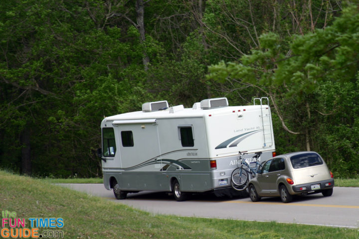 Rv Towing A Car Behind It Four Wheels Down