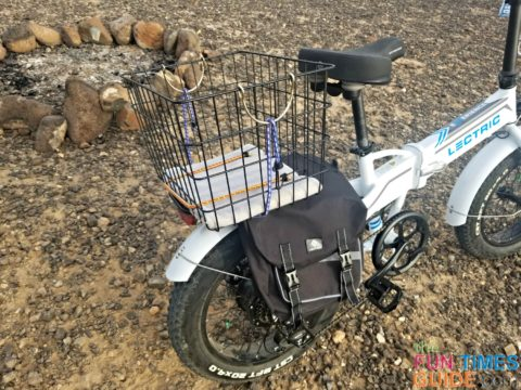I added a wire basket from Walmart onto the back of my eBike -- so I can ride with my little dog.