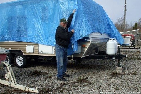 removing-tarp-rv-storage