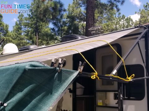 The sun shade rope reinforces the RV awning fabric.