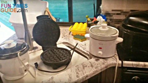 Necessary camp cooking equipment: rice cooker, waffle maker, crock pot, turkey roaster.