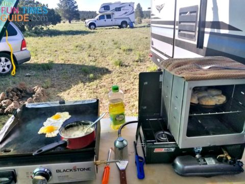 Making breakfast and sweet rolls in a camp oven for breakfast while camping.