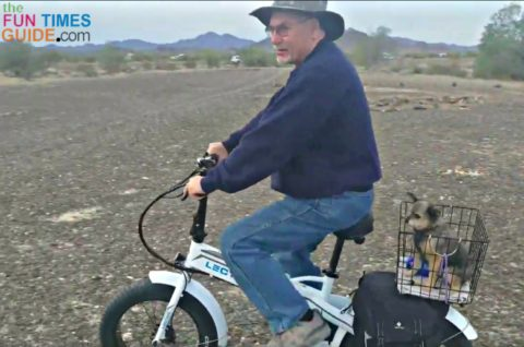 Bike riding on my new electric bicycle... with my dog Max in the bike basket.