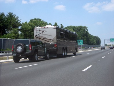 rv-motorhome-towing-hummer-by-vees.jpg
