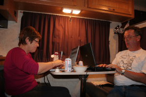 Using the RV dining table as office space while on the road. photo by margaritanitz on Flickr