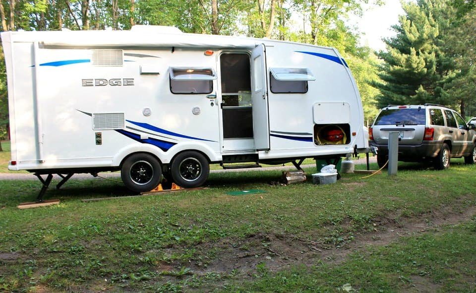 See Why Parking Your RV On Grass Is A Bad Idea! (Plus, 3 Alternative Parking On Grass Solutions)