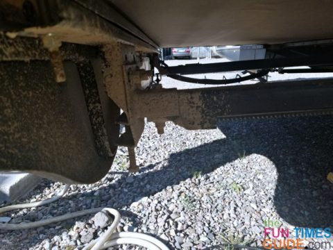 A closeup of the rack and gear mechanism underneath my RV slide-out.
