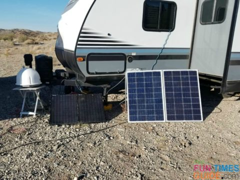 a 100-watt SV Solar Suitcase next to a homemade 200-watt suitcase