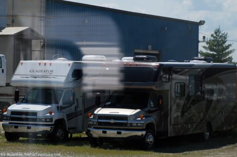 Two RVs being parked for long periods of time.