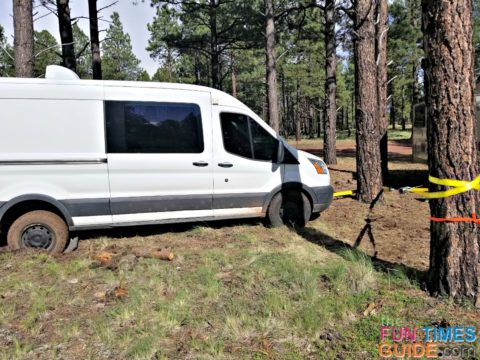 Using a come along to get RV van unstuck in the mud.