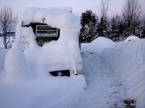 vehicle-buried-in-snow-by-origamidon.jpg