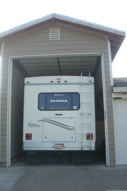 An rv garage protects your rv investment from sun for Rv garage